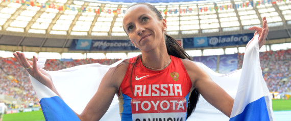 Russia's Mariya Savinova celebrates after winning silver medal during the women's 800 metres final at the 2013 IAAF World Championships at the Luzhniki stadium in Moscow on August 18, 2013.       AFP PHOTO / KIRILL KUDRYAVTSEV        (Photo credit should read KIRILL KUDRYAVTSEV/AFP/Getty Images)